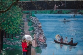 Milton, Ontario engagement photo shoot | The Mural on the wall and the couple under an umbrella