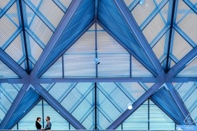 A couple shares a silent moment on the upper level of the gallery - National Gallery of Art East Wing Engagement Portraits