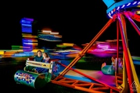 Anne Arundel County Fair engagement portrait session at night - Cute couple on the scrambler!