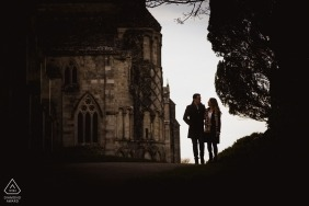 Engagement portraits from Christchurch Priory | posing for a session before their wedding