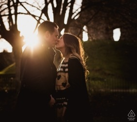 Christchurch Priory engagement photos | portraits of a couple at sunset shooting into the sun