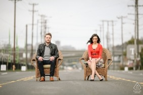 Downtown Seattle engagement photos | Couple sitting on chairs in the middle of Seattle street