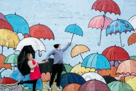 Tacoma, Washington Photo session | engaged Couple jumping with wall of umbrellas