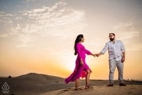 Couples soul shoot holding hands during the Dubai Sunset in the desert by UAE wedding photographer