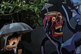 Diablo Pub Pré-wedding couple portrait session with a light, an umbrella, and graffiti mural art on the wall