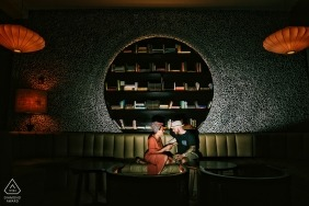 Playa del Carmen, Mexico engagement portrait - bride and groom reading a book