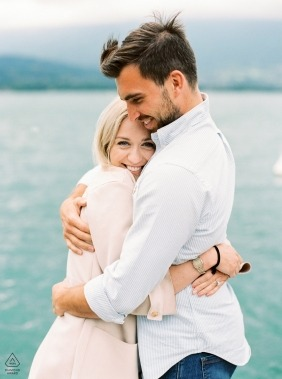 Wedding film photographer in Annecy, French Alps | a vertical pre-wedding portrait at the water