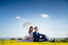 Engagement photos from Bakersfield, CA | Under the sky, sitting on the grass With a sun umbrella