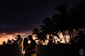 Poipu, Kauai, Hawaii Engagement PhotoShoot | Silhouette portrait of a couple during a storm after sunset