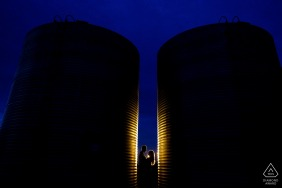 Dodd Lake Rural Engagement Photo Session between a pair of silos on a farm in Boulder, Colorado