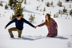 Sapphire Point Engagement Portrait -  Reactions after falling in the snow during their engagement session in Dillon