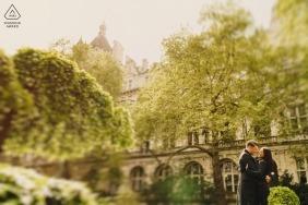 London Engagement Photographer | Colour image tilt shift of couple in rain