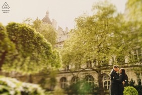 London Engagement Photographer | Colour image tilt shift of couple in rain