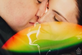 London Pre-Wedding Engagement Photography - Colour image of close up with rainbow lens flare
