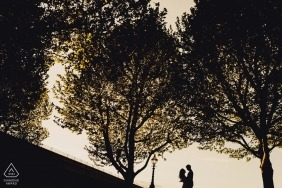London Colour Engagement Portrait Session - Image of couple silhouetted in the sky with trees