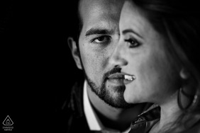 Black and white engagement portrait of a couple with their faces aligned in perfect union in Reggio Calabria.