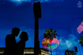 Venice, California Engagement Portrait - I love you Matcha sign reflection with a silhouetted couple