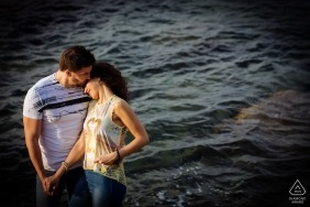 Calabria - the happy couple poses in front of choppy water in this engagement shoot