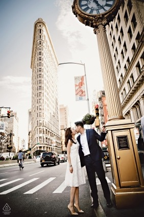 Engagement Portrait Kiss in front of Flatiron building, NYC