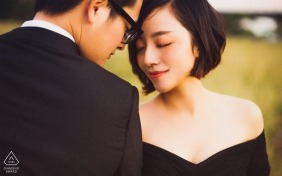 Guangdong - couple leans their foreheads against each other and close their eyes peacefully in this pre-wedding portrait session
