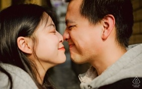 Guangdong - the couple give each other eskimo kisses in this pre-wedding portrait
