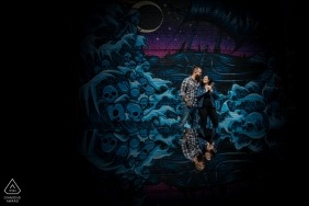 Minneapolis, Minnesota Couple Engagement Portrait in front of painted mural