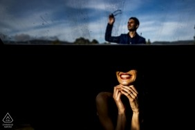 A man and woman are contrasted in dark and light in this engagement photo session by a Reggio Calabria photographer.