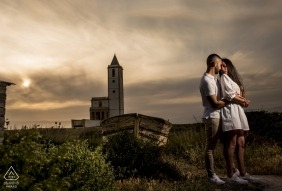 A couple stands in front of the Cabo de Gata as the sun sets in this engagement photo by a Murcia, Spain photographer.