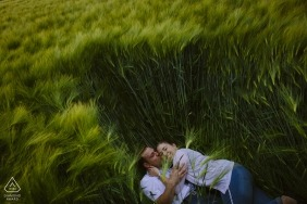 Engagement Portrait of Couple in Grass in Aachen