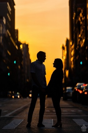 Silhouetted couple share a moment during their engagment shoot in New York City