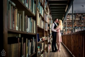 Engaged couple kissing in the library of Bovendonk for pre wedding portrait