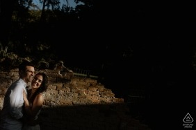 A couple in O Butia, Alegre is cast half in light, half in shadow during their pre-wedding photoshoot by a Rio Grande do Sul, Brazil photographer.