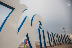 """Wildwood New Jersey Engagement Photographer: """"As soon as I saw that sign I knew I wanted something like this. I had to wait for a few tourists..."""""""