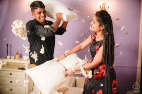A couple has a fun pillow fight in Bangalore in this pre-wedding photo session by a Karnataka photographer.