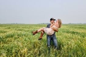 Alberta, Canada Engagement Photographer captured this photo of a couple kissing in a field
