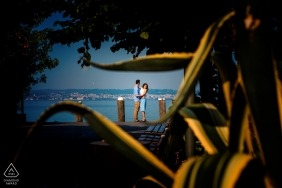 An engaged couple hug in their Engagement photo session in Sirmione, Italy