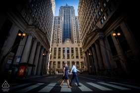 board of trade, chicago engagement shoot with a couple walking down the street