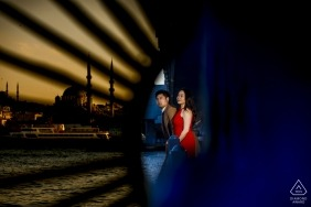 A couple looks out over the water in Istanbul during their engagement photo session by a Turkey photographer.