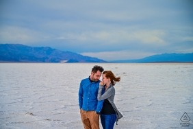 A couple walks together along the Salt Lake during their pre-wedding photo session by a Sao Paulo, Brazil photographer.
