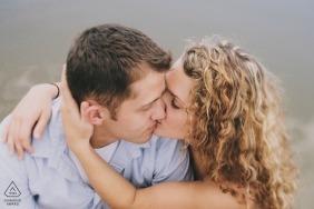 Salt Lake City, Utah Engagement PhotoShoot - A Couple kisses passionately next to pond
