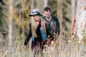 Carbonado, WA engagement photography - Couple walks through the forest