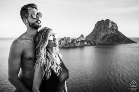 Ibiza engagement photographer caught this black and white photo of this couple on the beach of Es Vedra Island