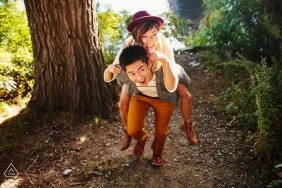 Cambridge Massachusetts Engagement photograph of couple giving piggy back