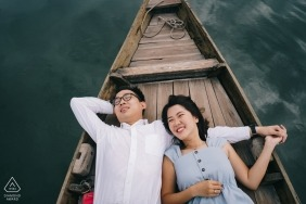 Hoi An love engagement picture session in a boat on the water