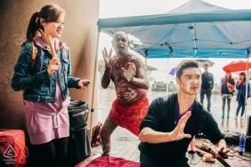 The engaged couple learns about the performance of the indigenous people on the streets of Sydney