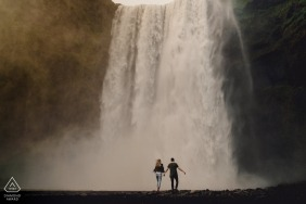 Iceland Engagement Photography | Couple with large waterfall in the background