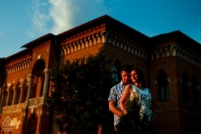 Engagement shoot with a couple posing in front of the Mogosoaia Palace