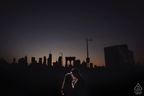 Brooklyn Bridge engagement couple portrait at night