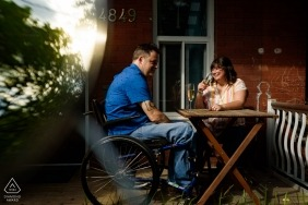 Montreal, Quebec Engaged couple relaxing on front porch together for a portrait