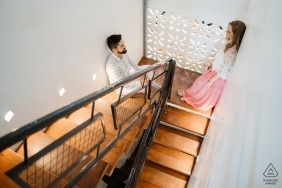 Brasilia - Brazil Engagement and Pre Wedding Portraits - Couple on stairs where they saw each other for the first time.